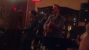 One-half of Jersey band Wyland pefroming on vocals and guitars getting jazzy.