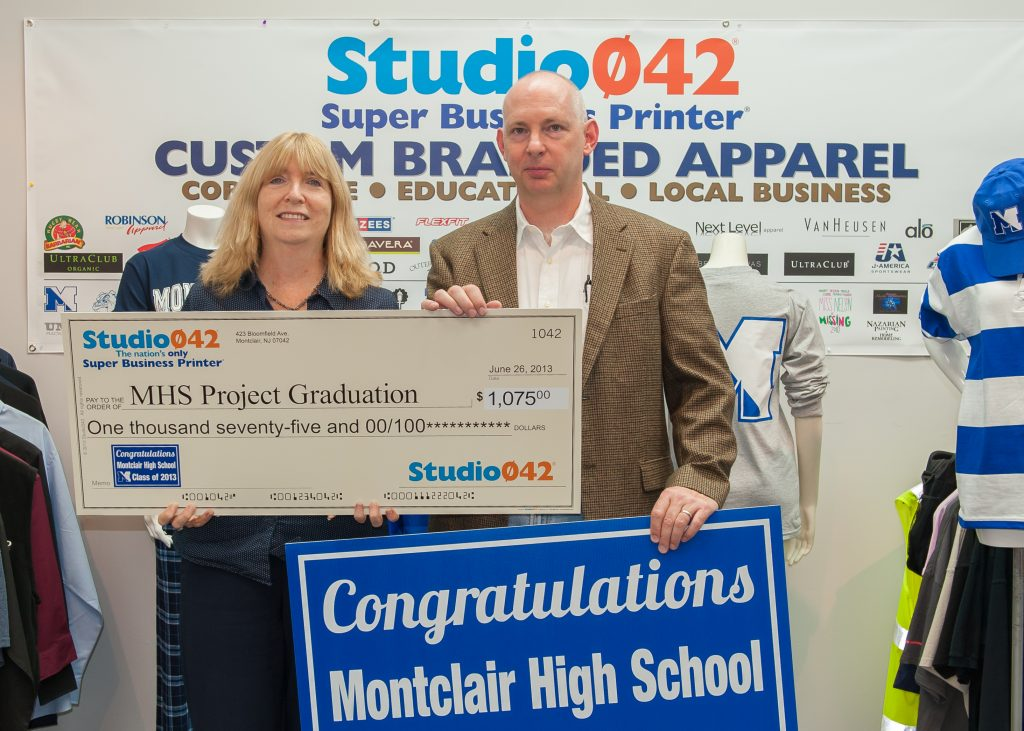 Scott Kennedy from Studio042 presenting a donation for Project Graduation 2014.