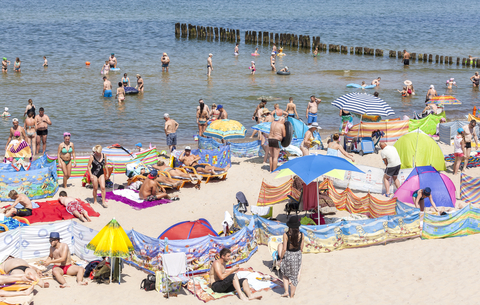 Crowded beach in Dziwnowek, one of the most visited summer spots