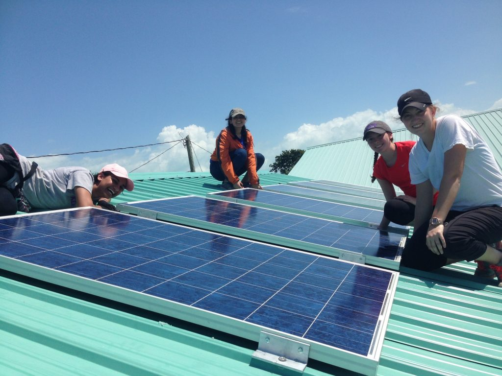 Clara Altfeld '19, Carolina Andrade '19, Caitlin Kennedy '19, and Meredith Glover '20 on the roof in Sarteneja, Belize.