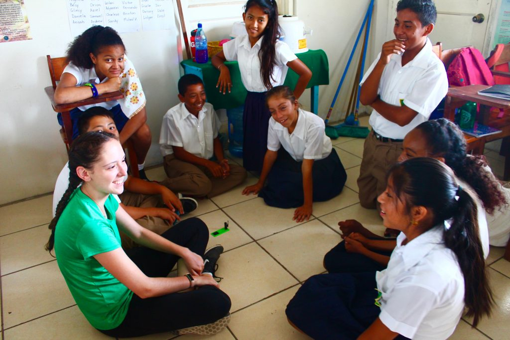 Caitlin Kennedy '19 teaching a solar power lesson at Corozal Methodist School in Corozal, Belize using a mini solar powered fan to demonstrate how solar power generates electricity.