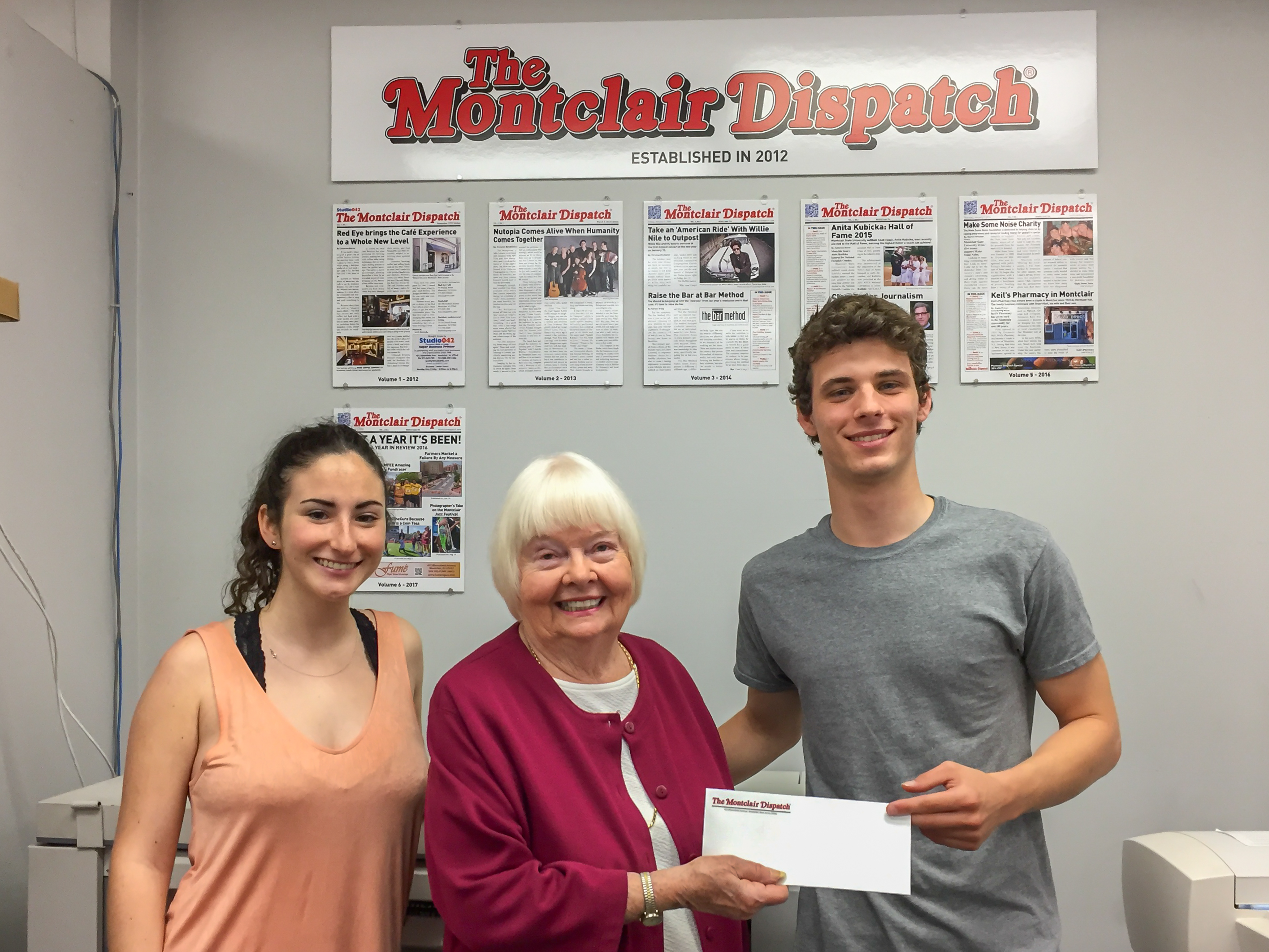 Joe receiving his scholarship check from Catherine Boone, sister of Eleanor Kennedy whom the scholarship is named after.