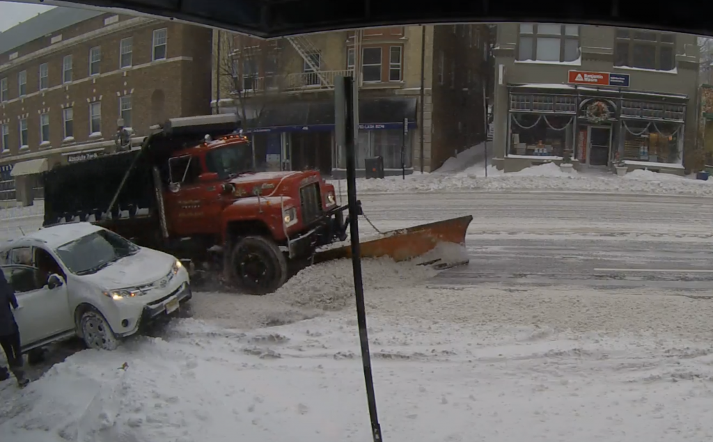 Cars blocking a snow plow on Bloomfield Avenue prevent the plows from clearing the parking lane, Image / the Montclair Dispatch