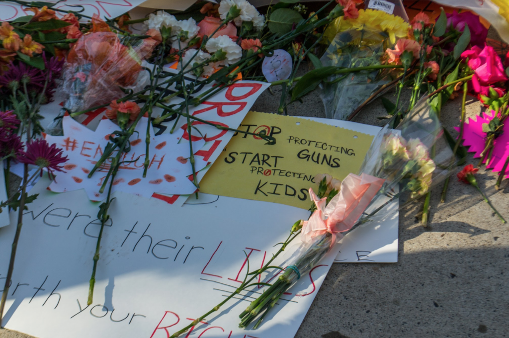 signs and flowers in a show of respect