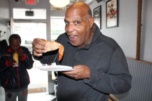 Mayor Jackson Enjoying a Slice! // Photo Courtesy of VioletPR